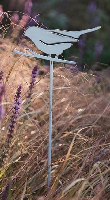 White bird on a stake
