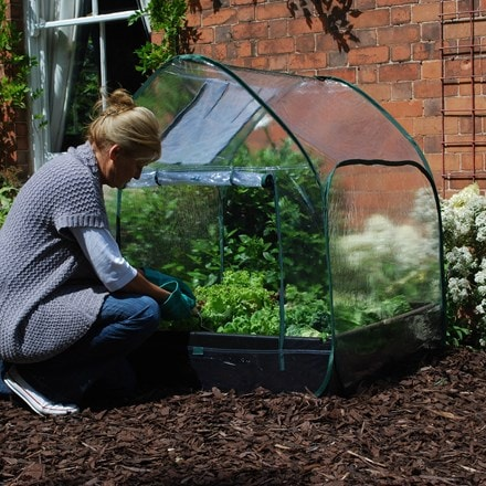 Pop up cloche cover for raised bed