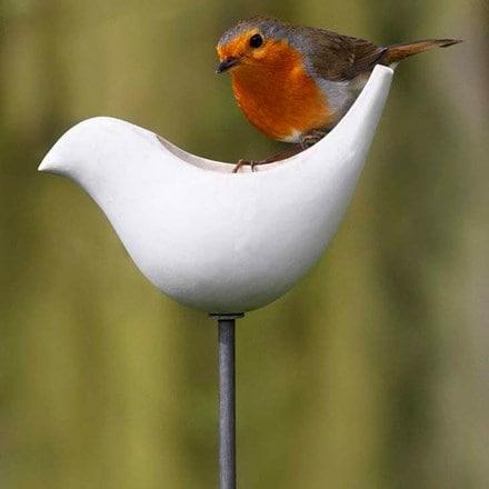 Porcelain bird feeder on a stake