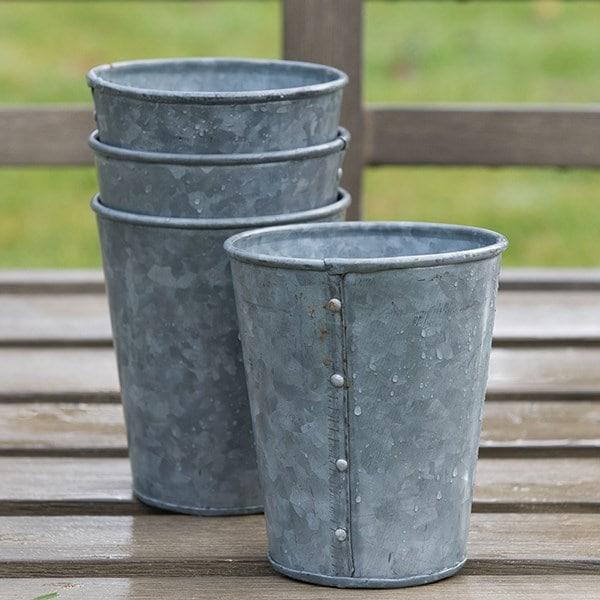 Set of six galvanised pots