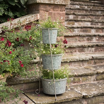 Tiered corner stand with three galvanised pots