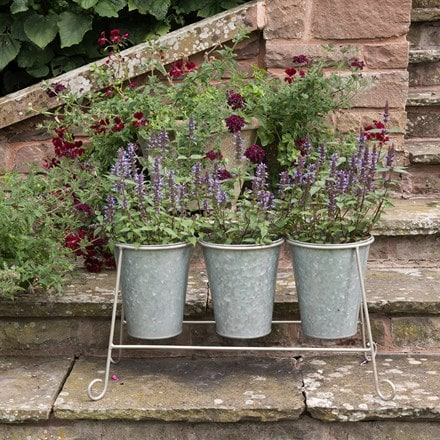 Three galvanised pots and stand