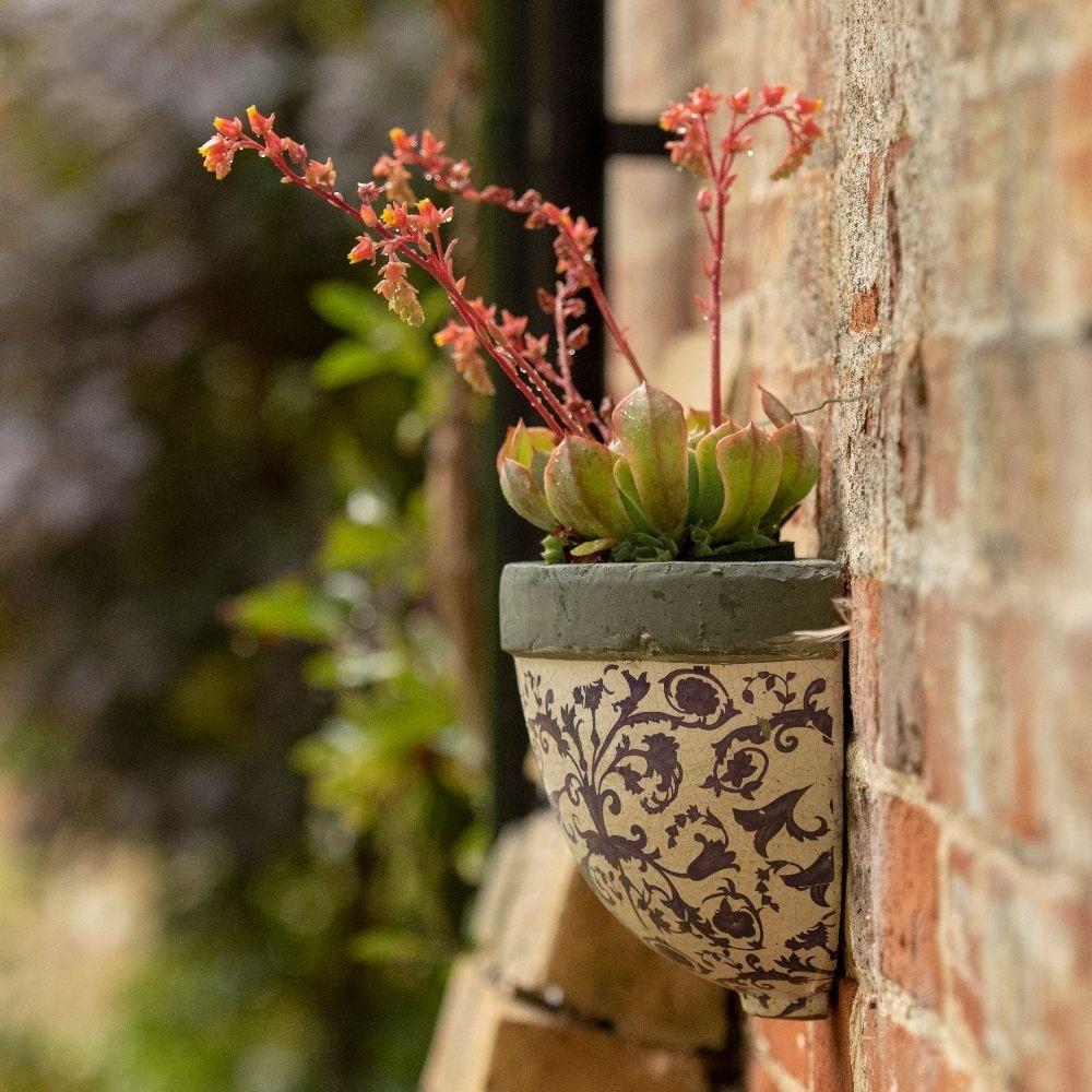 Half round aged ceramic wall planter