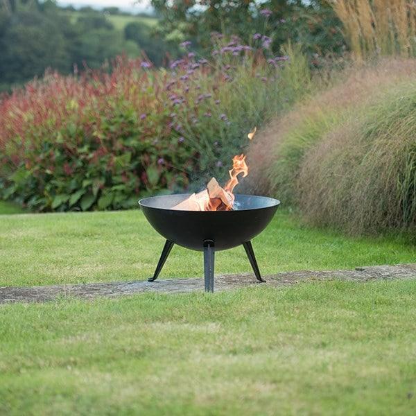 Iron fire pit bowl with cast iron tripod base