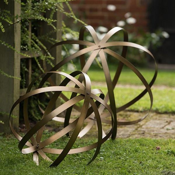 Sculptural sphere brass