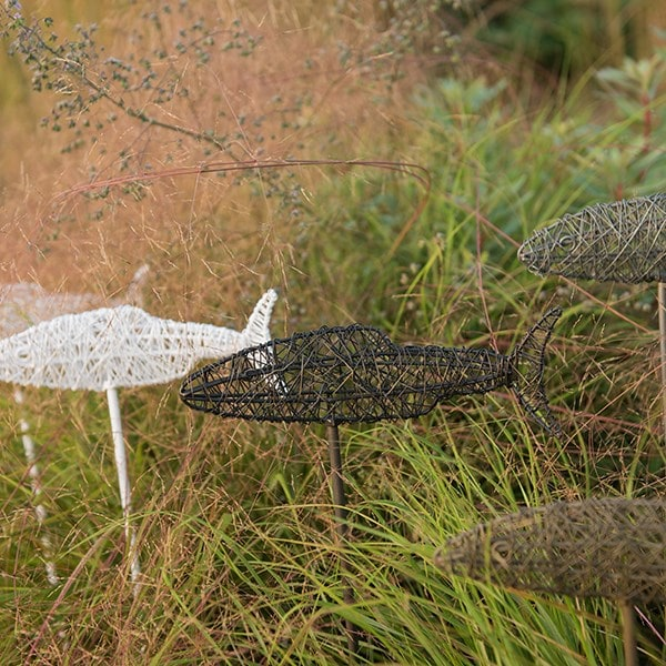 Wire fish on a stake - brass