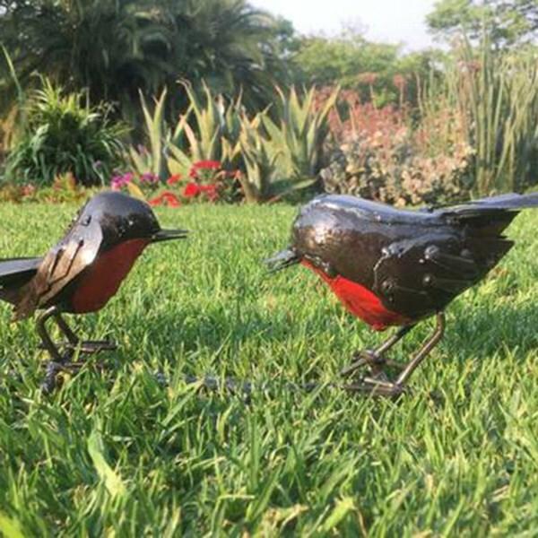 Metal robins on branch
