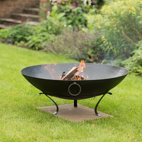Iron disc fire pit bowl with tripod base