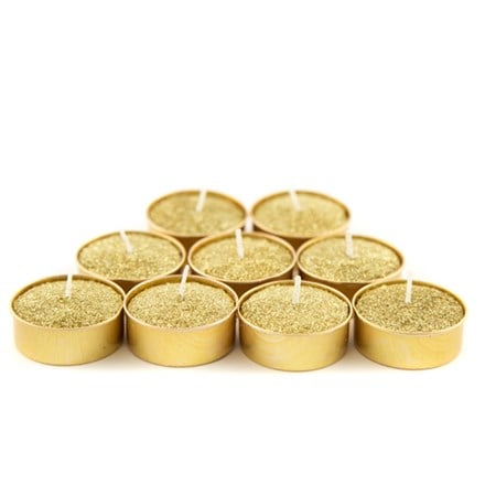 Gold glittered wax tealight