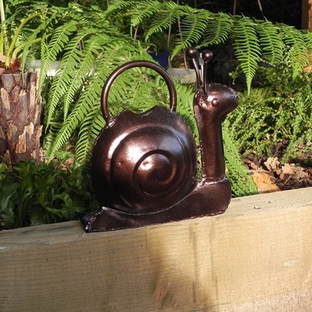 Ornamental watering can - snail