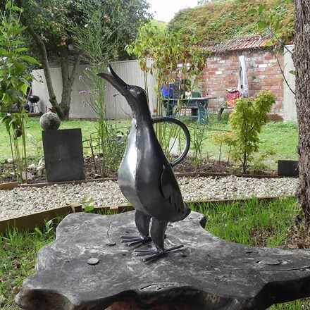 Ornamental watering can - singing duck