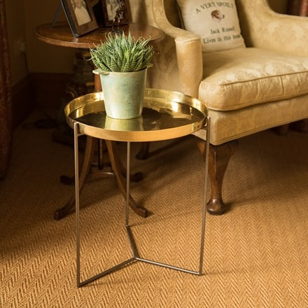 Indoor table with brass plant tray