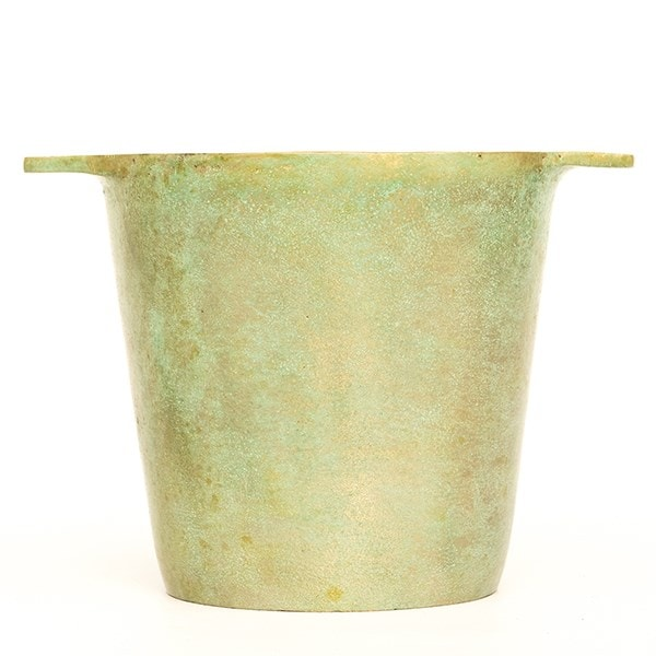 Cast aluminium pot cover with verdigris patina