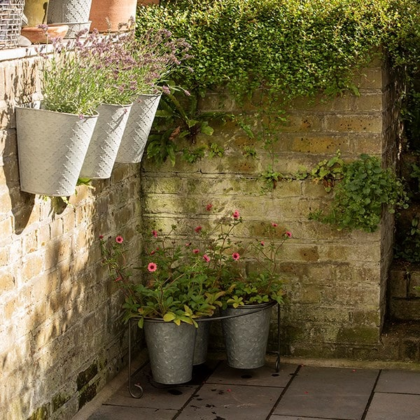 Corner pot stand with three deep galvanised pots