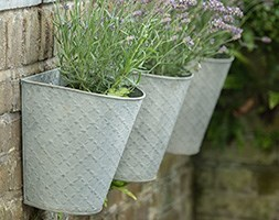 Set of three embossed wall planters