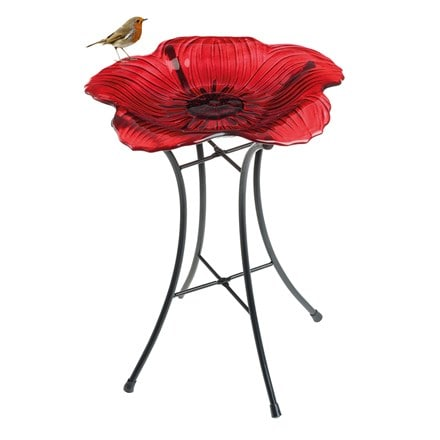 Ornamental glass poppy bird bath