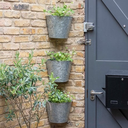 Set of three galvanised corner wall planters