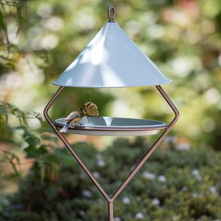 Bird feeding hut on stake - eau de nil