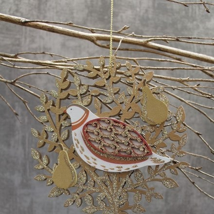 Fretwork wood partridge in pear tree