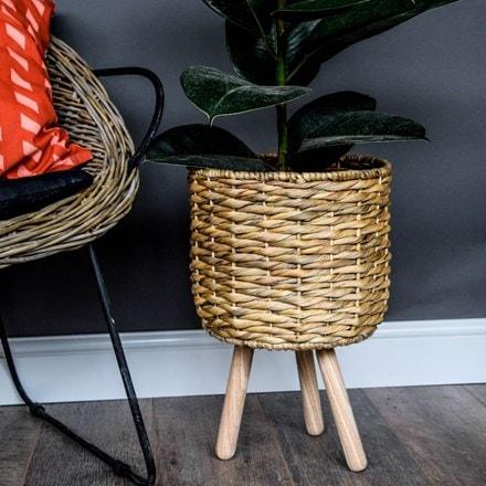 Water hyacinth lined basket on legs