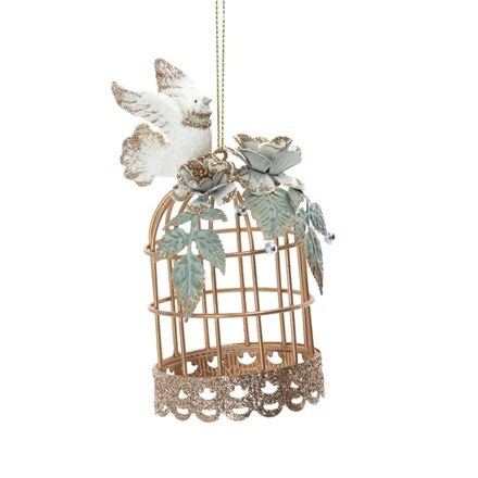 Gold wire bird cage with dove