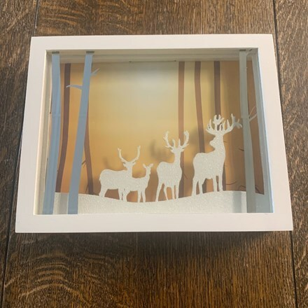 Holographic reindeer family scene