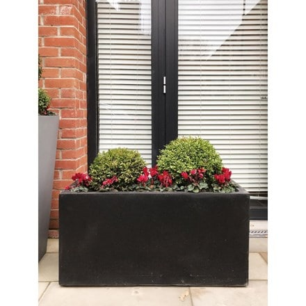 Contemporary black light concrete trough planter