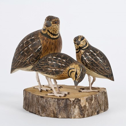 Hand carved wooden quail family