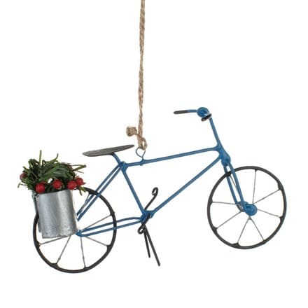 Blue bike with barrel of holly